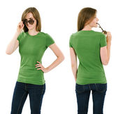 Young brunette woman with blank green shirt — Stock Photo