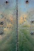 Metal plate with rivets — Stock Photo