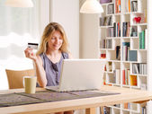Shopping online with a credit card — Stock Photo