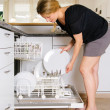 Stock Photo: Unloading dishwasher