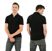 Young man with blank black polo shirt — Stock Photo