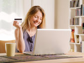 Internet shopping with a credit card — Stock Photo