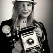 Beautiful female retro photographer — Stock Photo