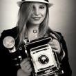 Stock Photo: Beautiful female retro photographer