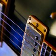 Electric guitar strings and pickups — Stock Photo