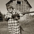 Angry woman with big gun — Stock Photo #3083675