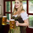Stock Photo: Oktoberfest waitress serving beer