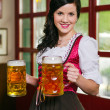 Stock Photo: Beautiful Oktoberfest waitress with beer