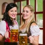 Beautiful Oktoberfest waitresses with beer — Stock Photo