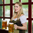 Serving beer during Oktoberfest — Stock Photo