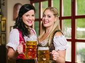 Beautiful Oktoberfest waitresses with beer — Stock Photo
