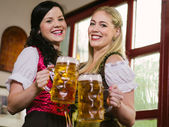 Gorgeous Oktoberfest waitresses with beer — Stock Photo