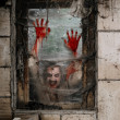 Hungry zombie at the window — Stock Photo