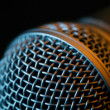 Vocal microphone macro over dark background — Stock Photo #33502849