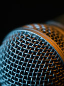 Vocal microphone macro over dark background — Stock Photo