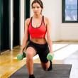 Female doing lunge exercises — Stock Photo