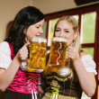 Beautiful women drinking Oktoberfest beer — Stock Photo