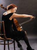 Cello player enjoying her music — Stock Photo