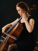 Cellist and her old cello — Stock Photo