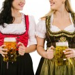 Women with dirndl and Oktoberfest beer — Stock Photo