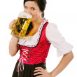 Woman wearing dirndl and drinking Oktoberfest  beer — Stock Photo