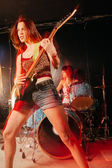 Female guitarist and drummer — Stock Photo