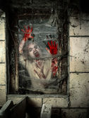 Undead at the window — Stock Photo