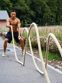 Outdoor fitness with training ropes — Stock Photo