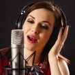 Singing into professional microphone — Stock Photo #41497981