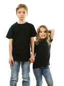 Young children wearing blank black shirts — Stock Photo