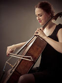 Smiling Cellist playing her old cello — Stock Photo
