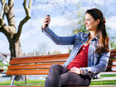 Smiling woman taking a selfie — Stock Photo