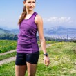 Woman stretching her legs before running — Stock Photo