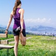 Woman stretching in the park — Stock Photo