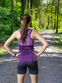 Runner looking at the path through the forest — Stock Photo