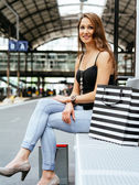 Young woman waiting at the train station — Stock Photo
