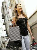 Young woman in the city shopping — Stock Photo