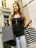 Young woman shopping in the city — Stock Photo