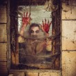 Bloody zombie at the window — Stock Photo #48432871