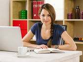 Student studying in front of laptop — Stock Photo