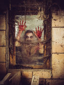Bloody zombie at the window — Stock Photo