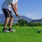 Golfer swinging driver — Stock Photo #49397209
