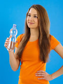 Happy young woman drinking water — Stock Photo