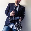 Photographer with vintage camera — Stock Photo #50305155