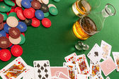 Gambling table with cards and poker chips — Stock Photo