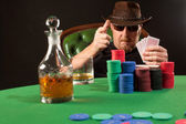 Poker player wearing sunglasses and hat — Stock Photo