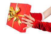 Hand giving gift — Stock Photo