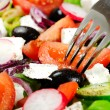 Salad and fork — Stock Photo