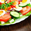 Plate with salad — Stock Photo #22102421