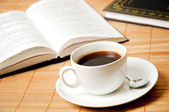 Cup of coffee with books — Stock Photo